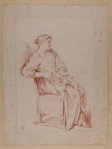 Estudio de mujer sentada en un sillón