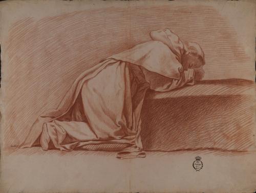 Estudio de monje postrado sobre un escalón