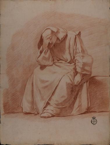 Estudio de monje sentado rezando el rosario