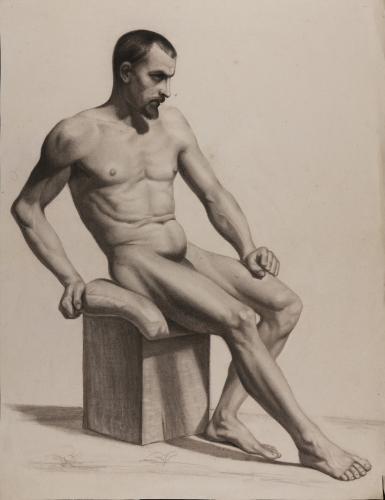 Estudio de modelo masculino sentado apoyado en su brazo derecho