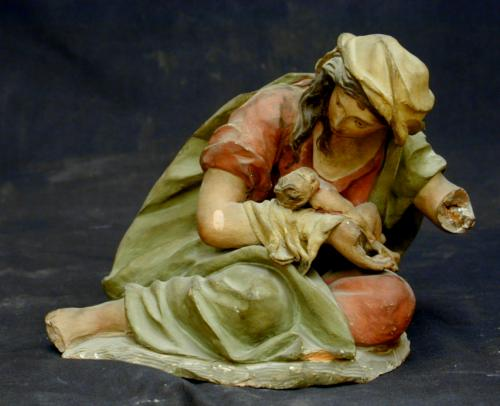 Madre con su hijo muerto