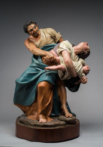 Sayón atacando a una madre con su hijo